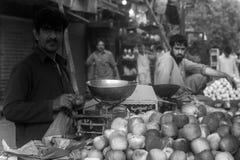 Selling Fruits. Pakistani man selling fruit in Local Market, Karachi Sindh, Pakistan.nPhoto taken on: October 4th, 2015 Royalty Free Stock Images