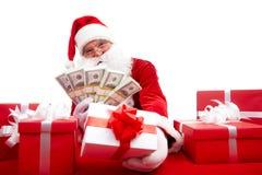 Selling gifts. Photo of happy Santa Claus selling Christmas gifts and looking at camera Stock Photos