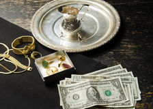 Selling gold for cash Royalty Free Stock Photo