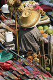 Selling her souvenirs. Selling everything in the Damnoen Saduak Floating Market in Thailand royalty free stock photo