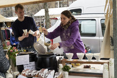 Selling homemade soup at the market Stock Images