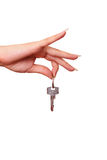 Selling house - giving key - isolated. Woman hand is giving key when selling home - isolated on white Stock Photography