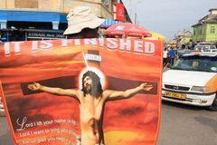 Selling Jesus posters on African street Royalty Free Stock Photography