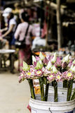 Selling Lotus Flowers for offering sacrifice Buddha Statue in Cambodia. Beautiful decorated lotus flowers are preparing for sell in local market nearby a temple Stock Image
