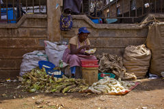 Selling maize at a market Royalty Free Stock Images