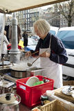 Selling and making fresh crepes at the market Stock Photo