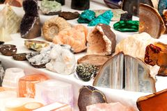 Selling mineral at the market. Decorative stones. Different types of colored minerals. stock images