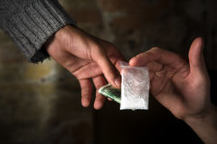 Selling narcotics and drugs. Money and narcotics concepts. People buying narcotics. Drug dealer selling narcotics to people. Drugs concept Royalty Free Stock Photo