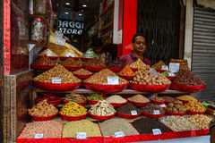 Selling nuts and dried fruits at a bazaar in India royalty free stock photography