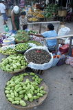 Selling off assorted fruits and vegetables  busy market Royalty Free Stock Image