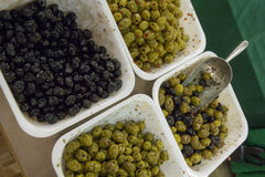 Selling olives at the market Royalty Free Stock Photos