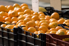 Selling Oranges. Fruit sold at open market Royalty Free Stock Photography