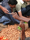Selling potatoes at the  weekly market Royalty Free Stock Photo