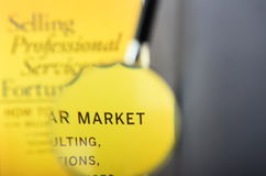 Selling professional services. A yellow book with the words selling professional services printed on it stock images