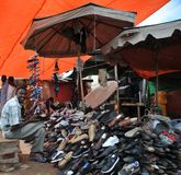 Selling shoes on the street of African city of Hargeysa Royalty Free Stock Photo