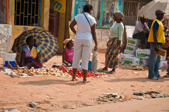 Selling in the street. The photo was taken near Maputo, the capital city of Mozambique, Africa. It represents a very much encountered scene in Africa: people Royalty Free Stock Photo