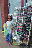 Girl Selling Sunglasses Stock Photo