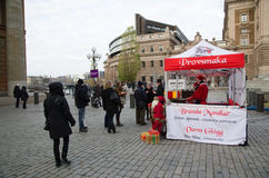 Selling sweet almonds by the parliament house in Stockholm Stock Photos