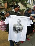 Selling a T Shirt at the Funeral of the President royalty free stock images