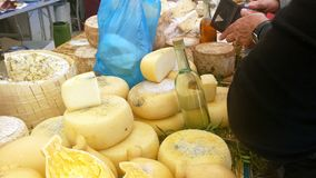 A selling table with local cheese called. `pecorino` and alcohol called `su filu `e ferru` or `acquavite` in Sardinia during a local party called ` sa sagra ` Stock Image