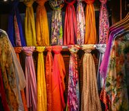 Selling textile silk at street market royalty free stock images