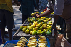 Selling tropical fruits Royalty Free Stock Image