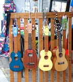 Selling Ukuleles and other String Instruments. KAOHSIUNG, TAIWAN -- APRIL 23, 2016: Outdoor vendors sell musical string instruments at the 1st Pacific Rim Stock Photos