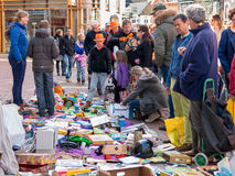 Selling used goods on King's Day flea market in Holland Royalty Free Stock Images
