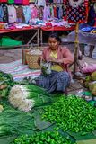 Selling vegetable at rural market stock images