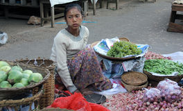 Selling vegetables in a Burmese market Stock Photography
