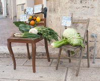 Selling vegetables on a chair Stock Photo