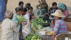 Selling vegetables at the local market Stock Image