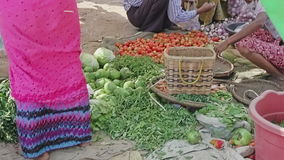 Selling vegetables at the local market stock footage