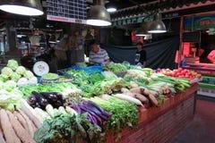 Selling veggies in wet market in downtown Shanghai Stock Photos