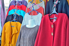 Selling women`s jackets and sweaters made of wool on the market Stock Image