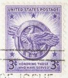 sello 1946 que honra a los que tienen servidor Fotografía de archivo libre de regalías