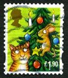 Sello BRITÁNICO de la Navidad del gato y del ratón Imagen de archivo libre de regalías