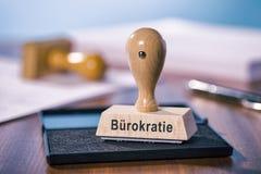 Sello con la burocracia de la palabra Fotografía de archivo libre de regalías