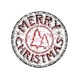 Sello de goma de la Feliz Navidad Imágenes de archivo libres de regalías