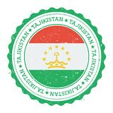 Sello de goma del Grunge con la bandera de Tayikistán Fotografía de archivo libre de regalías