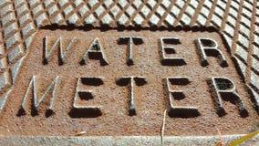 Sello de la acera del contador del agua Imágenes de archivo libres de regalías