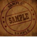 Sello de la MUESTRA en el papel arrugado viejo marrón Fotos de archivo libres de regalías
