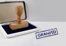Sello de madera CONCEDIDO imágenes de archivo libres de regalías