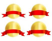 Sello del oro con la cinta roja Imagen de archivo libre de regalías