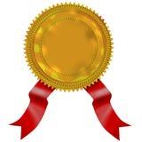 Sello del oro con la cinta roja Foto de archivo libre de regalías