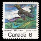 Sello impreso por el Canadá, cuervo grande de las demostraciones, por Emily Carr Imagen de archivo