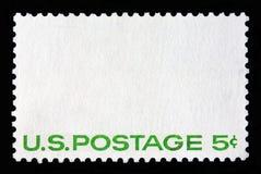 Sello postal blanco con el franqueo de escritura 5c de los E.E.U.U. imagen de archivo