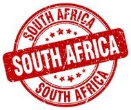 Sello redondo del grunge rojo de Suráfrica Foto de archivo libre de regalías