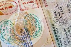 Sellos chinos de la visa y del aeropuerto en pasaporte Imagenes de archivo