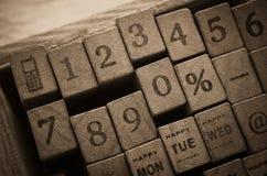 Sellos de goma con meteorología, monetario, días en semana y número Imagenes de archivo